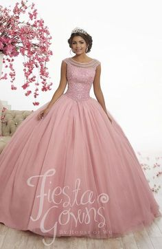 Wu Fiesta 56340 has sparkling sequins that dot this tulle ball gown skirt. The bodice is covered with colored replica pearls and small AB stones and finished with beaded illusion cap sleeves and a cutout lace-up back. Xv Dresses, Quince Dresses, Fashion Dresses, Prom Dresses, Wedding Dresses, Pretty Quinceanera Dresses, Pretty Dresses, Tulle Ball Gown, Ball Gowns