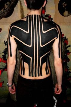 Even the most simple blackwork design can be visually striking, as you can see in this massive piece. #inked #inkedmag #back #blackwork #blackink #solid #ink #tattoo #style