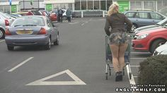 English milf Daniella in arse revealing mini skirt, pantyhose and ankle boots at the supermarket.
