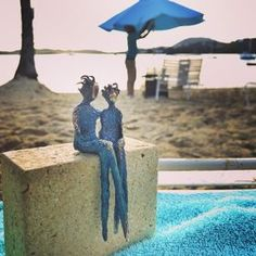 Little blue people, with wild hair celebrating a big day in the tropical Virgin Islands by Yenny Cocq