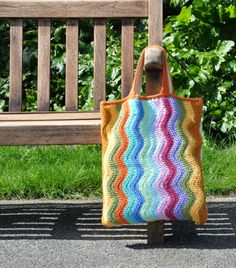 14.25 X 15.75. ie: 36 X 40cm  What a joy to behold, these lovely rippled stripes in colours ranging from hot yellows and orange to cool blues and greens. Each side is a different combination of the same colours, I cant choose a favourite, can you?  Suitable to be used for your daily shop, or as a carrier bag round the market, ideal book bag for students, or as a knitting or crochet project bag for when your on the go.  I dont like to carry heavy shopping on my shoulder, its much easier to…