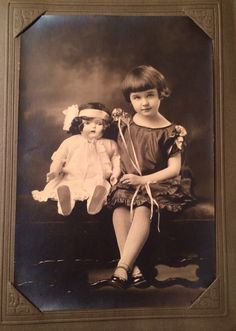 """""""My grandmother, 1925. She won the doll, that had a phonograph in its body, in a contest."""""""