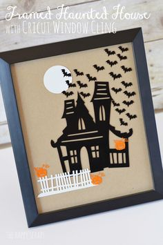 Framed Haunted House - Create this using your Cricut and the new Cricut Window Cling material.