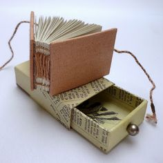 Pocket size book and little box to keep it in. Look into creating something like this.