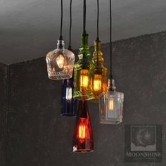 This is a 6 pendant chandelier made from recycled bottles. The rubber cords are mounted to a 12 birch plywood canopy with a 15.25 diameter metal decorative surround. Available finishes for the metal are oil rubbed bronze, dark bronze, copper or textured black. The wood can be stained or