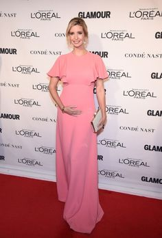 Ivanka Trump in a pink gown and holding her pregnant belly on the red carpet at the 2015 Glamour Women Of The Year Awards.