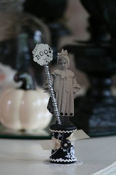 Vintage boo girl on wooden thread spool...{Photo} I could make this with a Vintage Image!  Could do this with a picture of a child with a message to their mom, dad for Mother's say or Father's Day.