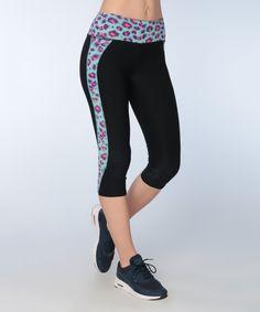 Take a look at this Body Blast Blue Cheetah Capri Leggings today!