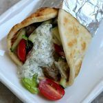Instant Pot Beef Gyros--Tender pieces of beef with soft onions, juicy tomatoes, crisp lettuce, creamy cucumber yogurt sauce all wrapped up in pita bread.