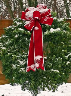 Super wreath.  Big and simple with the red bow. Perfect :)
