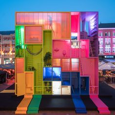 Dutch studio MVRDV has built a colourful, futuristic hotel, made up of nine rooms that can be moved into different configurations