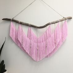 #fbf to creating this soft pink tapestry with hanging rose quartz crystals Swipe for a closer look . . . #pink #handmade #ooak #wallart #instaart #radicalsoulscollective #rosequartz #crystals #macrame #tapestry #fringe