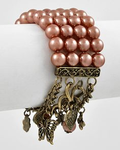 Pearl Charm Bracelet--here's a heretical thought: my generation; between the radical left and the radical civil rights movement, all of this beauty would have been eradicated !  (i'm laughing, hope you do to !!!)