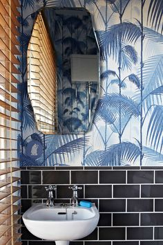 This stylish London loo feels like a tropical jungle with the addition of the classic Cole & Sons Palm Jungle wallpaper. - Design Sponge