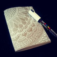 Zentangle illustration with uniposca. Handmade notebook.