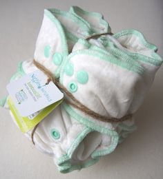 Our new and improved version 2.0 incorporates serged outer stitching (instead of turned/topstitched) for a trimmer fit. It also no longer has sewn in soakers #newborndiapers #clothdiapers #fittedclothdiapers from Nuggles Designs Canada