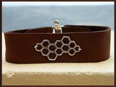 ▶ Jewelry How To - Make Leather Cuff Bracelets - YouTube Like the idea but would  not use glue...maybe hand stitch??