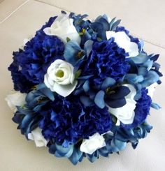 Royal Blue Carnations with White roses and Medium blue Lisianthus. - would love it if it had casa blanca lilies and calla lilies