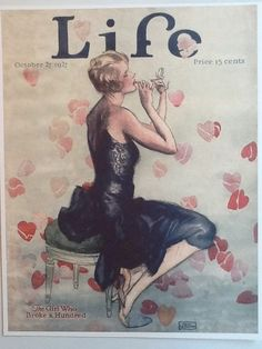 Vintage cover of 1927 issue of Life magazine.  Beautiful flapper girl putting on lipstick.  11x14 print available on Etsy.