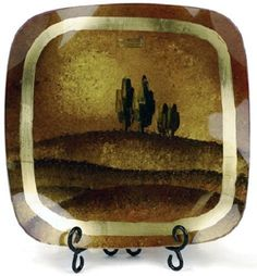 Cressida Glassware 'Village Entrance Series' 13-Inch Abstract Square Fused Glass Plate with Glass Ball Legs and Metal Stand by Cressida Glassware. $25.00. Each piece signed by the artist. These plates and platters are food safe. Handpainted and fused glass; delicate gold leaf accents. Breathtaking colors and one-of-a-kind design. Beautiful. Unforgettable. Affordable.. Exquisite handpainted fused glass pieces for your home by Cressida Glassware. Each piece personally painted...
