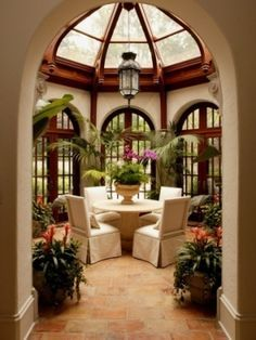 Delightful variation on the conservatory - a hexagonal wall of arched windows under a glass doomed roof with quarry tile floor makes for an intimate dining room. Maybe mirrors could be used in lieu of windows? 8f490d518d320c3f4a3498b67fe409ef.jpg (236×314)