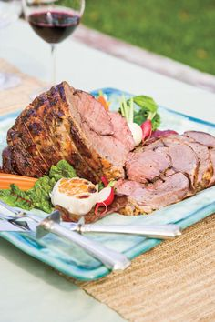 Roasted Lamb - Cat Cora's Greek Easter Menu - Southernliving. Recipe: Roasted Lamb  For savory Greek flavor, rub a lamb roast with lemon, oregano, salt and pepper; place garlic cloves around the roast; and drizzle with olive oil. Once cooked, garnish with roasted garlic cloves, baby carrots, radishes, and lettuce leaves.
