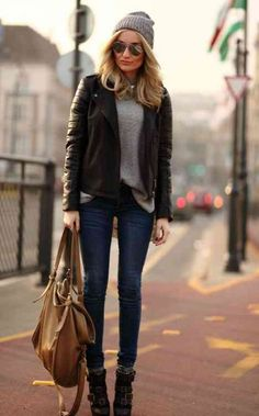 Jeans, grey top, leather jacket, & boots.