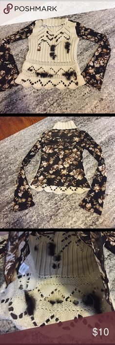 Sweater with sheer flowered print Cool looking sweater with some fur detailing on the front and sheer flower print on the back. Unsure of exact size but fits like a small. I normally wear a medium but the sweater fits me fine Sweaters