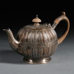Victorian Silver Teapot, London, 1890-91, John Septimus Beresford, maker, circular, bulbous form with a wood handle and finial, body decorat...