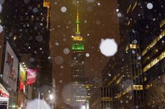 #snowmaggedon2015: snow falls around the Empire State Building in midtown Manhattan, on Monday, Jan. 26, 2015, in New York. Tens of millions of people along the Philadelphia-to-Boston corridor rushed to get home and settle in Monday as a fearsome storm swirled in with the potential for hurricane-force winds and 1 to 3 feet of snow that could paralyze the Northeast for days. (AP Photo/Patrick Sison)