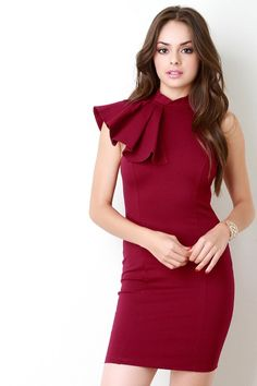 @modaonpoint This trendy dress features a stretchy knit fabric, mock neckline with an asymmetrical ruffle design, and sleeveless construction. Finished with a mini-length hemline and rear zip-up closure. Accessories sold separately. Made in U.S.A. 65% Rayon, 30% Nylon, 5% Spandex.