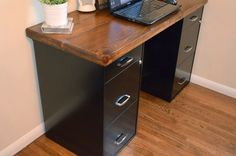 Putting a piece of wood on top of a pair of file cabinets or sawhorses is a tried-and-true method for getting a home office set up quickly and cheaply