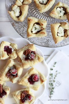 You're going to want to make the caramelized onion and goat cheese puff pastry bites and raspberry jam, brie and walnut bites