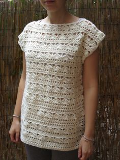 Ivory lace sweater hand crafted crochet. Boat neck and sleeveless.