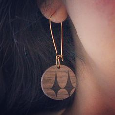 @thecheshirekat4: Another new item added to my store today! Laser engraved walnut earrings with a fun retro design. Part of my mid century inspired collection. CheshireKat.Etsy.com