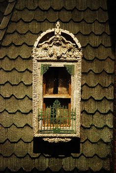 Window detail on a dollhouse in the Miniatures Museum of Taiwan. The Miniatures Museum of Taiwan is the first museum to collect miniatures in Asia. The museum was founded on March 28, 1997 by Mr Lin Wen-ren and his wife. It is located in Taipei City, Taiwan. (V)
