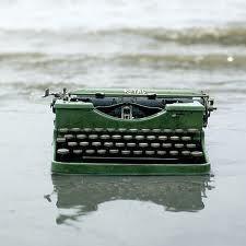 green typewriter washed ashore