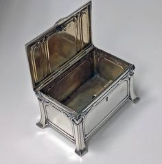 View this item and discover similar for sale at - Austrian silver casket box, Vienna, circa The box of strong jugendstil nouveau secessionist design on four turned bracket stylized bracket supports, Silver Enamel, Antique Silver, Arts And Crafts Movement, Casket, Decorative Objects, Art Decor, Art Nouveau, Boxes
