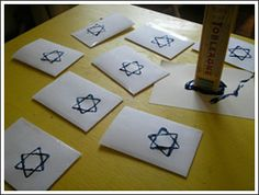 Using a toblerone bar's triangle shape to stamp star of david's on gelt envelopes