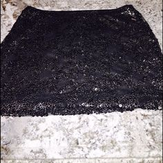 FLASH SALE!💥🆕 NEVER WORN Sequin Mini Skirt Black and Silver scattered sequin mini skirt. Never worn. Perfect for a night out! Express Skirts Mini