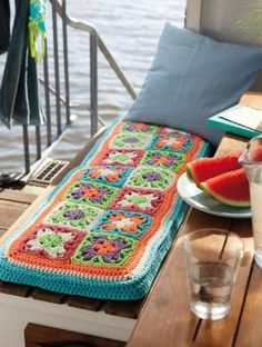 Inspiration ::  Bench pad covered with colorful granny squares.  #crochet