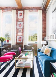 """""""The first thing I bought for our home was the pair of gray swivel chairs in our living room,"""" she said. """"I was still mulling the design direction over in my mind, but my husband really needed a..."""
