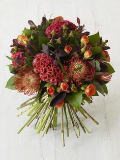 No Thanksgiving table is complete without a beautiful bouquet of flowers or two. Here are 16 flower arrangements to try this Thanksgiving—and where to order them. Fall Bouquets, Fall Wedding Bouquets, Fall Wedding Flowers, Fall Flowers, Floral Bouquets, Bridal Bouquets, Burgundy Flowers, Thanksgiving Centerpieces, Simple Centerpieces