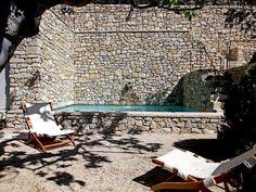 Hot tub outside & stone wall