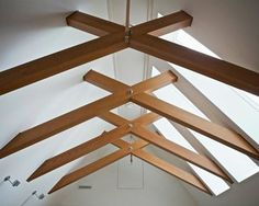 Consider the rule of three. Most successful lighting concepts use a combination of three types of lighting: ambient, task and accent. By layering all three in differing proportions, you can achieve professional results. Exposed Trusses, Roof Trusses, Farmhouse Skylights, Contemporary Kitchen Inspiration, Scissor Truss, Roof Truss Design, Vancouver, Timber Roof, Brick Accent Walls