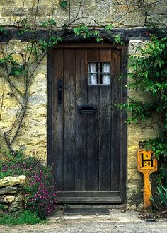 A cottage door in the town of Bibury located in the English Cotswolds region.