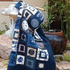 Styled shot of appliqué and patchwork japanese style quilt in japanese garden