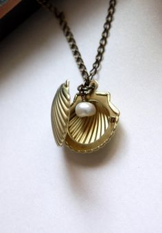 A Mermaids Locket. A Shell, Clam, Oyster Vintage Brass Locket Necklace. Romantic. For Sister, Mother, Wife, best friends.Wedding.. $17.50, via Etsy.