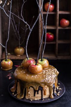 "Delicious caramel ""slime"" is the key to this gorgeous and gooey Salted Caramel Apple Snickers Cake."