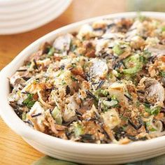 Chicken and Wild Rice Casserole    This isn't that same old-fashioned chicken casserole. Reduced-fat soup and semisoft cheese as well as fat-free milk update it for today's concerns about fat and calories.